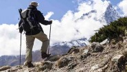 Man hiker in high Himalaya Mountains in Nepal. Trekking in summer nature